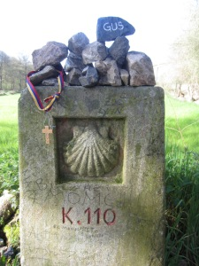 Rocks are left at the kilometer posts, we will leave a Gus rock and cross